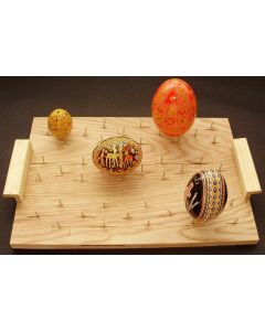 DRYING BOARD Holding up to 15 eggs for varnishing. It can also be used to melt wax from the egg in the oven
